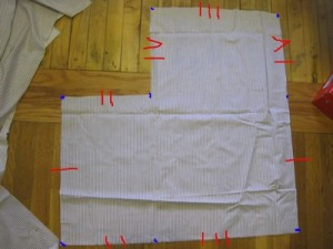 A piece of fabric with identifications drawn on to indicate which sides will be sewn together.